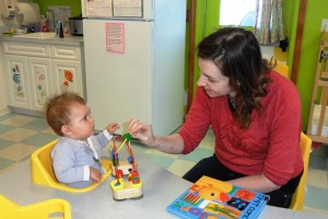 Brandi's Place Teachers work with babies to reach new heights